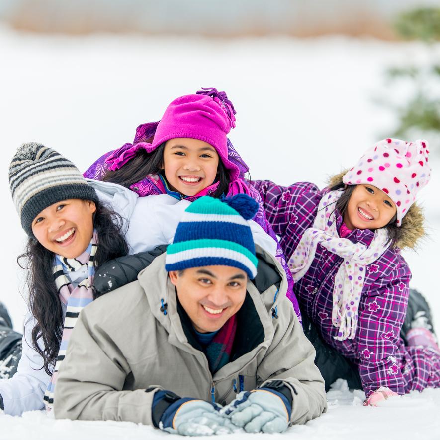 Asian family having fun in winter